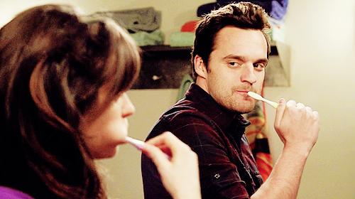 Nick Miller brushing teeth