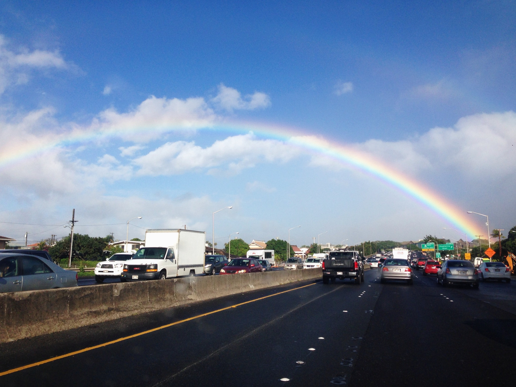Daily traffic in Hawaiʻi- always packed, always constant- the only plus- sometimes you see a rainbow. (Photo Credit Hoʻolaʻi Tjorvatjoglou