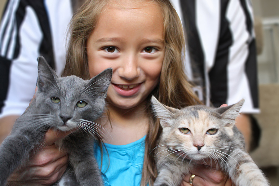 Samantha holding Smokey, left, and Sugar, right. Sugar looks utterly thrilled to be posing for pictures.