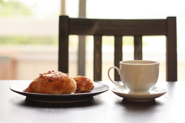 Still Life With Almond Croissant And Coffee by John Nakamura Remy