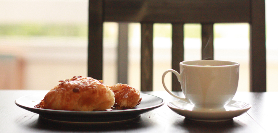 Still Life With Almond Croissant And Coffee by John Nakamura Remy_slide