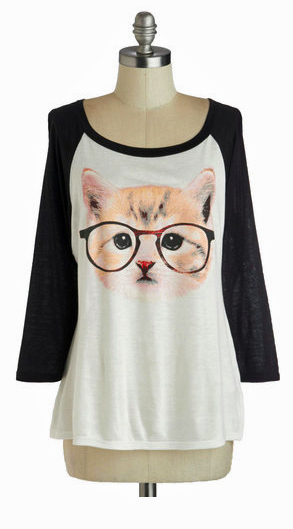 It's a kitten wearing GLASSES. There's nothing lady nerdier than this.