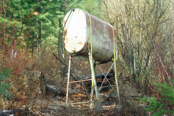 This 270 gallon water tank is placed on the hillside above the garden.