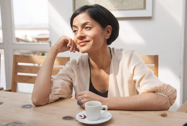 Simran Sethi drinking coffee