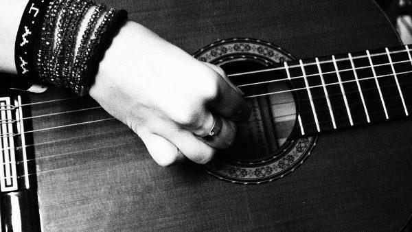woman-guitar-hand