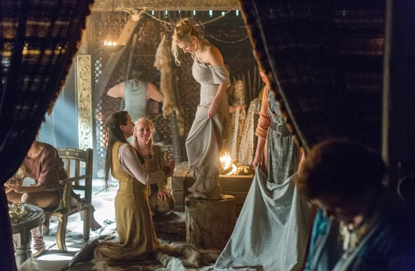 How many bridesmaids does Lagertha have attending to her in the wedding tent? (Before she sends them out, so she can kill Kalf.) Hint: the picture won't help you.