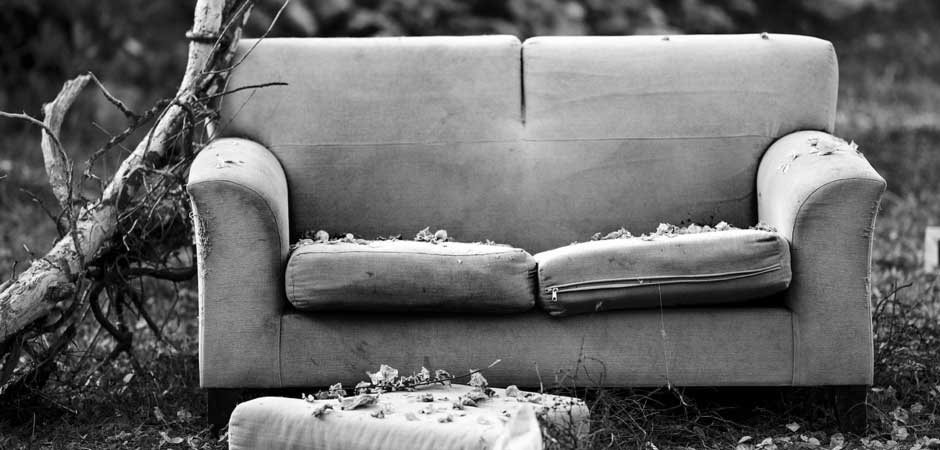 Abandoned couch, black and white photo
