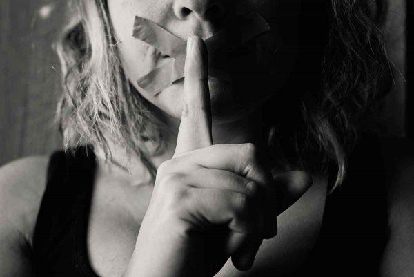 Woman silenced sad scared