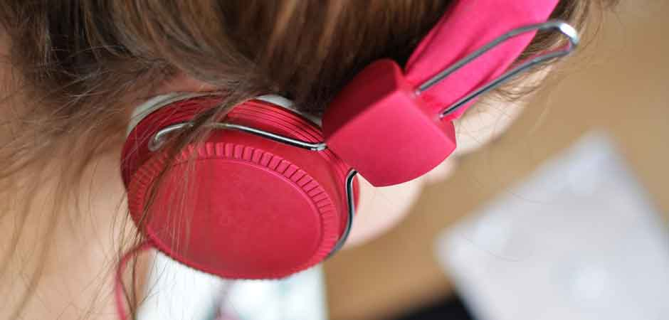 person woman headphones music pink